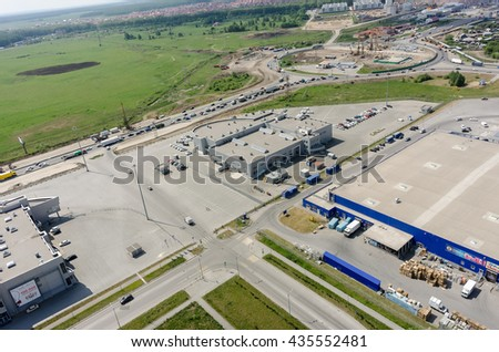 Tyumen, Russia - May 27, 2016: Aerial view onto trading centers and road construction on Fedyuninskogo and Melnikayte streets intersectiob - stock photo