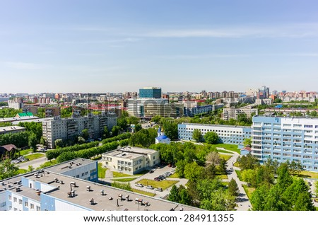 """Tyumen, Russia - May 25, 2015: Bird eye view onto Tyumen oil and gas university, 50 Let Oktyabrya street, Church in honor of Mother of God """"Healer"""" icon and regional clinical hospital No. 2 - stock photo"""