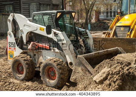 Tyumen, Russia - May 5, 2007:  skid loader working on road construction - stock photo