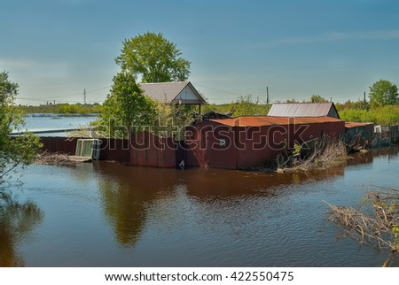 Tyumen, Russia - May 16, 2016: The spread river Tura has flooded the house on Tomskaya Street - stock photo