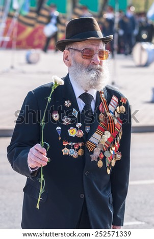 Tyumen, Russia - May 9. 2009: Victory Day in Tyumen. Elderly veteran of World War II walks outdoors - stock photo