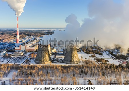 Tyumen, Russia - November 17, 2015: Aerial view on combined heat and power factory number 2 and city quarters - stock photo