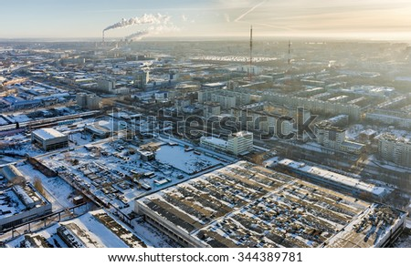 Tyumen, Russia - November 10, 2015: Aerial view on industrial and residential area and combined heat and power factory on background - stock photo