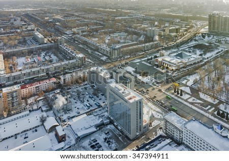 Tyumen, Russia - November 10, 2015: Bird eye view onto office buildings and Memory square