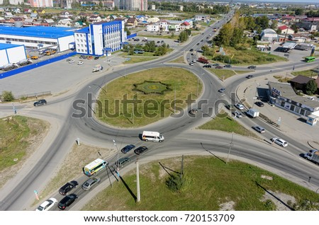 Tyumen, Russia - September 2, 2017: Aerial view onto Scherbakova and Veteranov Truda streets intersection