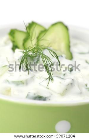 Tzatziki - Greek yogurt sauce with cucumbers, dill and garlic, known as tarator or snezhanka in Bulgaria or zaziki in Turkey. Shallow DOF - stock photo