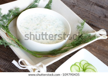 Tzatziki or tzadziki is a Greek and Turkish meze or appetizer, also used as a sauce for souvlaki and gyros. Made of strained yoghurt mixed with cucumbers, garlic and salt. - stock photo