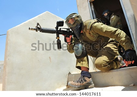 TZEELIM, ISR - MAY 23:Israeli special forces trains with paintball guns on May 23 2011.Paintball technology used by military forces, law enforcement and security organizations to save money and ammo. - stock photo