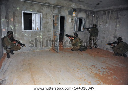 TZEELIM - NOV 10:Israeli soldier during Urban Warfare exercise on Nov 10 2010.Armed forces seek to train their units for those circumstances in which they are to fight. - stock photo