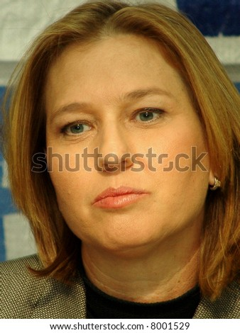 Tzipi Livni,  Israeli Foreign Minister. closeup portrait with Kadima party banner at the background.