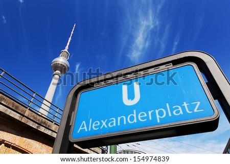 U-bahn Alexanderplatz sign and Television tower, German Fernsehturm. Berlin, Germany - stock photo