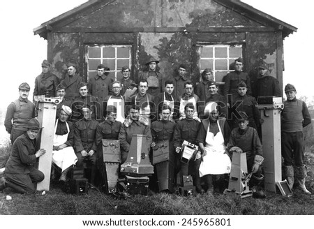 U.S. Army-Air Force 'Balloonatic Section.' Capt. A. W. Stevens (center, front row, with fur collar) and his personnel with the large camera's they used to photograph enemy positions. WWI. Ca. 1918. - stock photo