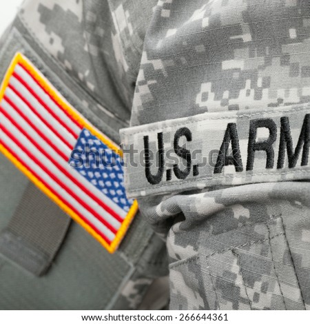 U.S. Army and flag patch on solder uniform - stock photo