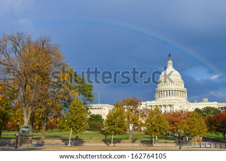 U.S. Capitol Building in Autumn with a rainbow over - Washington DC, United States