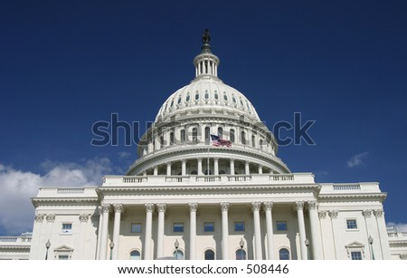 U.S. Capitol building in Washington, D.C., with the American flag flying on it. - stock photo