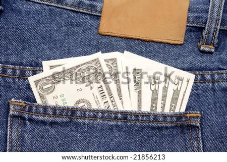 U.S. cash in denim jeans pocket - stock photo