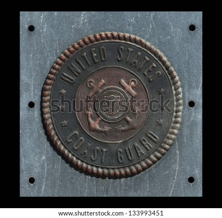 U.S. Coast Guard emblem on granite with black background - stock photo
