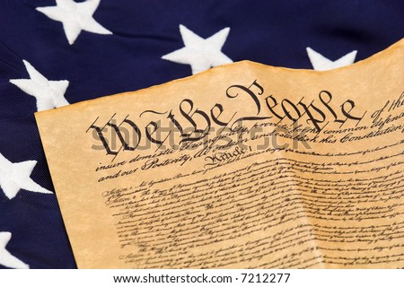 U.S. Constitution with stars on blue field background. - stock photo