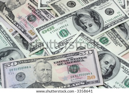 U.S. currency.  New 50 dollar and older style 100 dollar U.S. bills. - stock photo