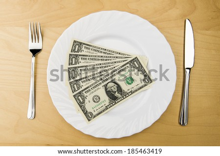 U.S. dollar bill on a plate