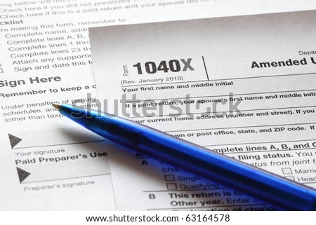 U.S. income tax form 1040X and a blue pen close-up. Shallow DOF.