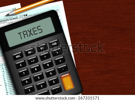 u.s. individual income tax return form 1040 with calculator and pencil lying on wooden table - stock photo