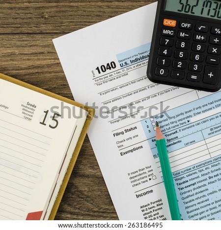 U.S. individual income tax return form 1040 with calendar - stock photo