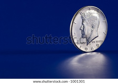 U.S. 1969 Kennedy Half Dollar - blue background with reflection in the foreground - stock photo