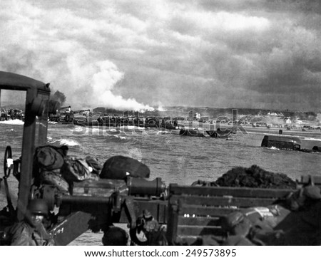 U.S. landing craft approaching Omaha Beach in Normandy beach on Dec. 6, 1944. Soldiers are standing on ships decks, indicating heavy German resistance had ceased. France, World War 2. - stock photo