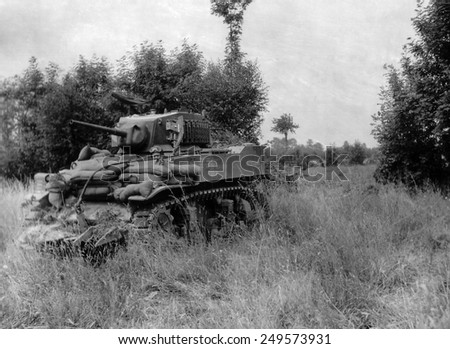 U.S. light tank equipped with the 'Culin Hedgecutter' for breaching the Norman hedgerows. The sharp blades were made from German steel obstacles on the invasion beaches. - stock photo