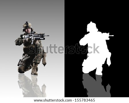 U.S. military marine. Studio shooting. with reflections. sitting pose. isolated. With alpha channel. - stock photo