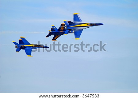 U.S. Navy Blue Angels Maneuvering with Vapor Trails
