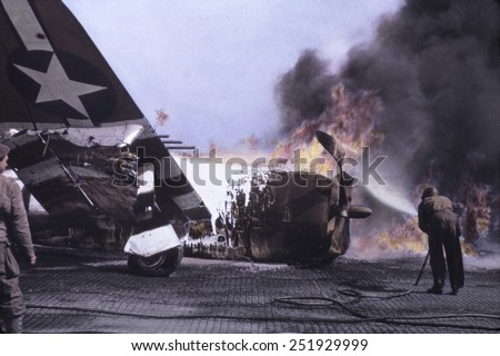 U.S. Republic P-47 Thunderbolt in flames after crash landing, Sainte-Mere-Eglise, France. June 1944, Normandy, World War 2. B&W Photo with oil color. - stock photo