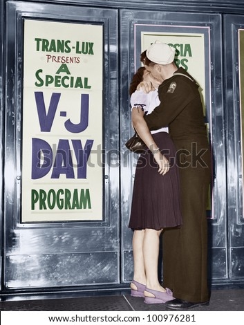 U.S. sailor and his girlfriend celebrate news of the end of war with Japan in front of the Trans-Lux Theatre in New York's Time Square, August 14, 1945 - stock photo
