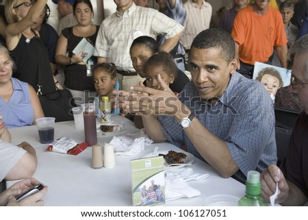 U.S. Senator Barak Obama campaigning for President while eating dinner at Iowa State Fair in Des Moines Iowa, August 16, 2007 - stock photo