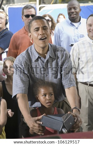 U.S. Senator Barak Obama campaigning for President with his daughter at Iowa State Fair in Des Moines Iowa, August 16, 2007