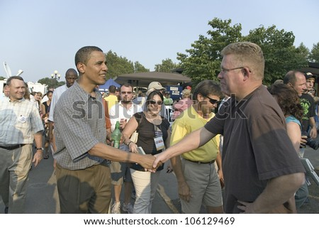 U.S. Senator Barak Obama shaking hands while campaigning for President at Iowa State Fair in Des Moines Iowa, August 16, 2007 - stock photo
