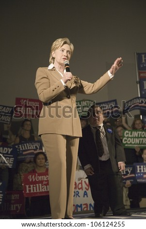 U.S. Senator, Former First Lady and Presidential Candidate, Hillary Clinton next to a midget at rally, following Iowa Democratic Presidential Debate, Drake University, Des Moines, Iowa August 19, 2007 - stock photo