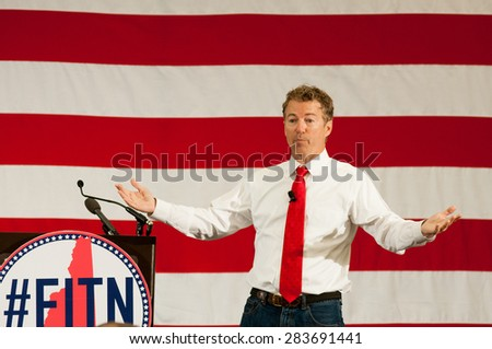 U.S. Senator Rand Paul, Republican of Kentucky, speaks at the First in the Nation Leadership Summit in Nashua, NH, on April 18, 2015.  - stock photo