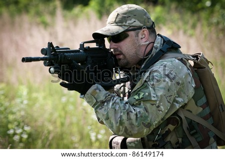 u.s. soldier in field - stock photo
