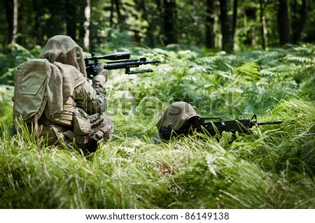 u.s. soldiers defending their position - stock photo