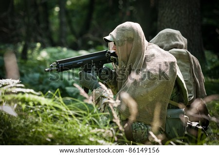 u.s. soldiers in forest - stock photo