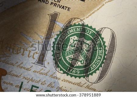 U.S. Treasury Seal on 100 dollar bill extreme macro - stock photo
