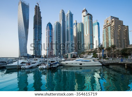 UAE Dubai 2015 Year november 19 . Dubai marina buildings in evening with water reflection