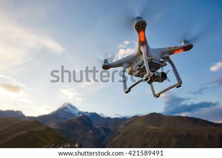 uav drone copter flying with digital camera - stock photo