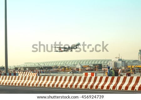 "UBAI, UAE - FEBRUARY 27, 2014: Aircraft take off ""Emirates"" airline in Dubai International Airport - stock photo"