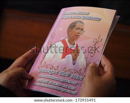 UBON RATCHATHANI, THAILAND - MAR 19, 2012 : The book mourn for the priest Luca Santi Wancha in his funeral on Mar 19, 2012 in Ubon Ratchathani, Thailand