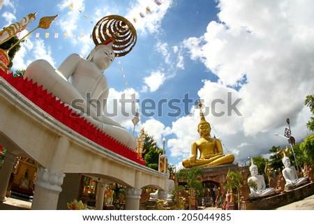 Ubon Ratchathani Wat Tai temple ,THAILAND - July 14 :Wat Tai temple and Buddhist sculpture,  on July 14, 2014, UbonRatchathani, Thailand - stock photo