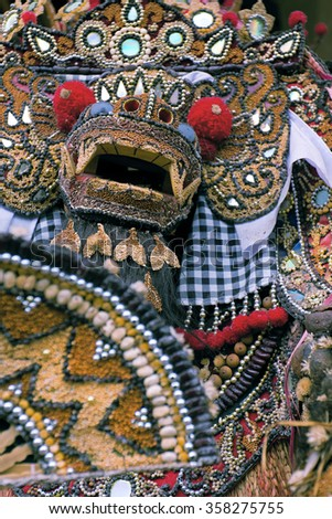 UBUD, BALI - CIRCA JAN 2011 - A Barong mask hand made from rice and beads. Barong is a lion-like character in the mythology of Bali and is king of the spirits.