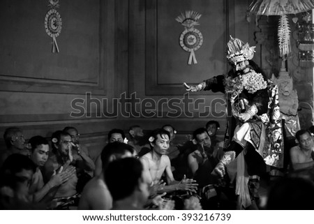 UBUD, BALI / INDONESIA - FEB 27, 2016: Unidentified dancers performing traditional balinese Kecak Trance Fire Dance. Kecak (also known as Ramayana Monkey Chant) is very popular cultural show on Bali.